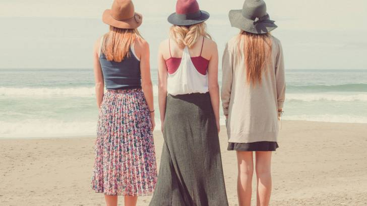 3 women standig on the beach