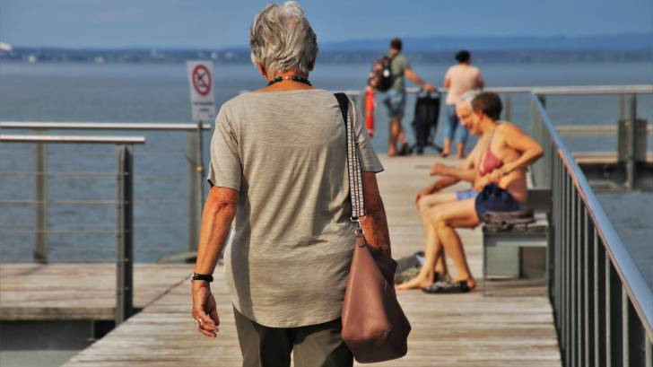 older people on a dock enjoying the day