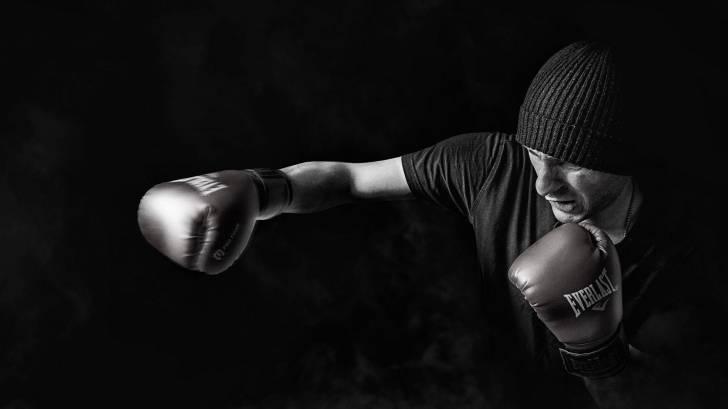 man shadow boxing