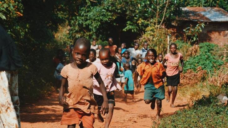 african children running laughing healthy