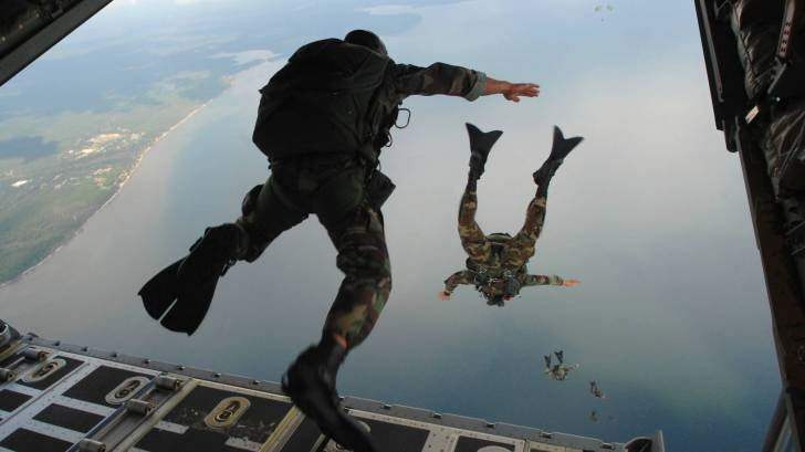 military diving out of plane