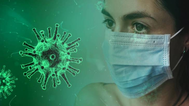 sars-cov-2 virus with women and a mask