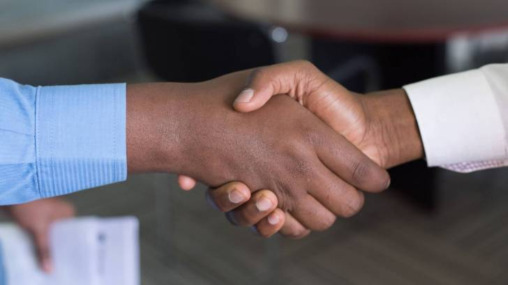 people hand shaking on a deal