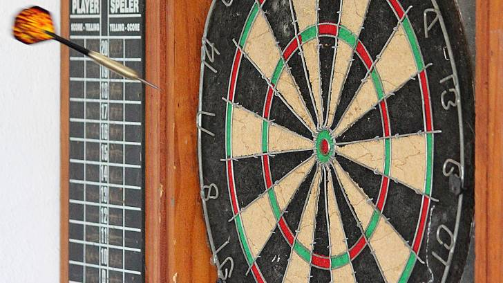 dart board, dart in the air towards the target