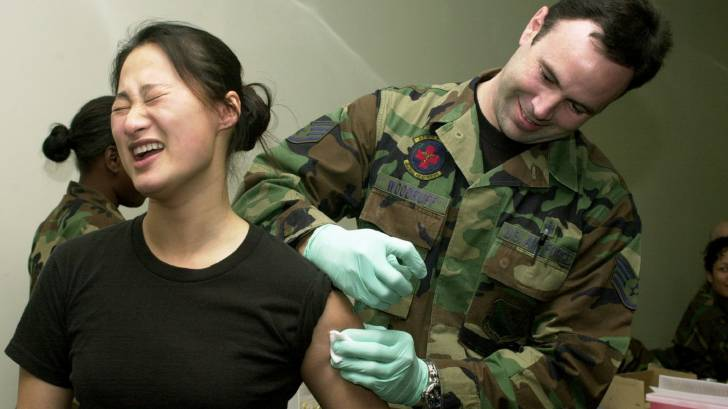 us military service woman getting a vaccination