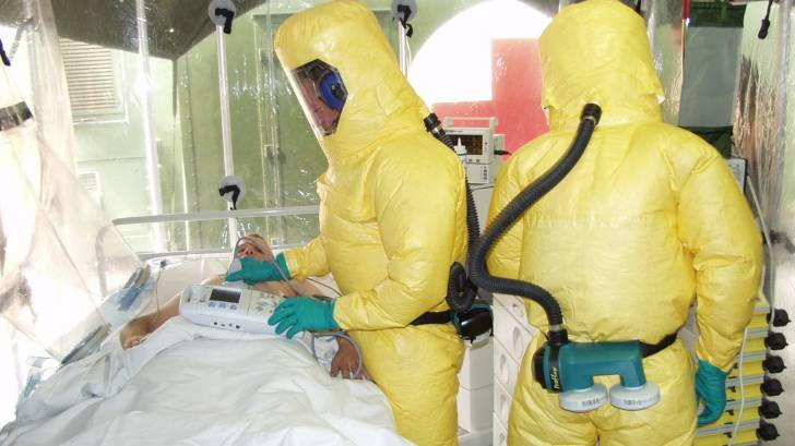 ebola patient being treated in an isolation tent