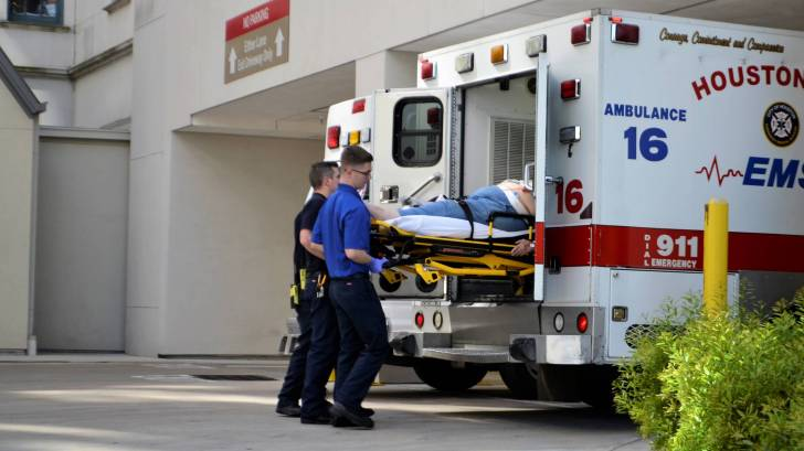 houston first responder with a patient going into ambulance