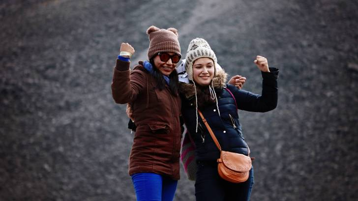 Happy friends on mountainside