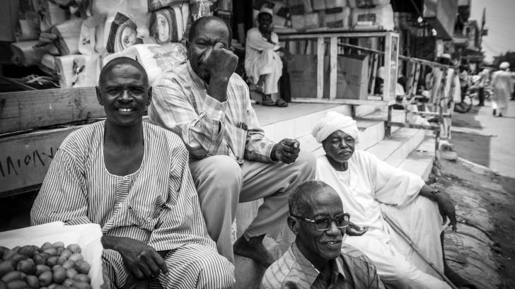 people in sudan talking and having fun