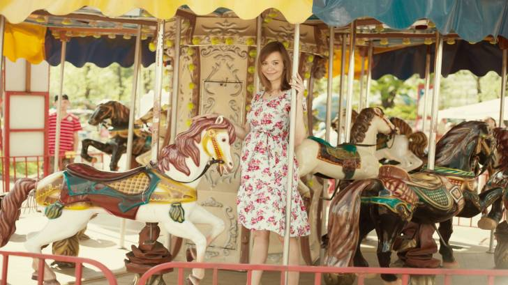 pregnant lady on carrousel