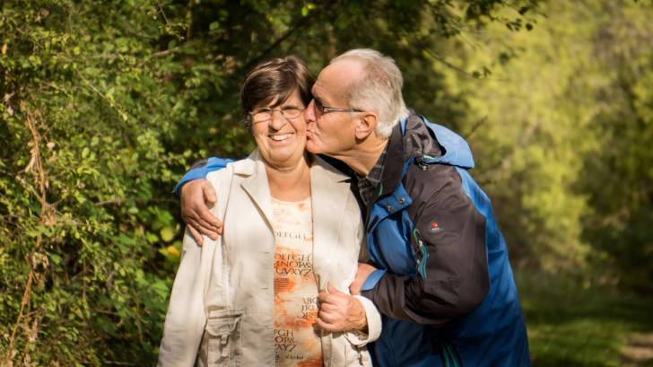 Seniors enjoying a kiss outdoors