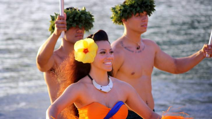 hula dancers on the beach