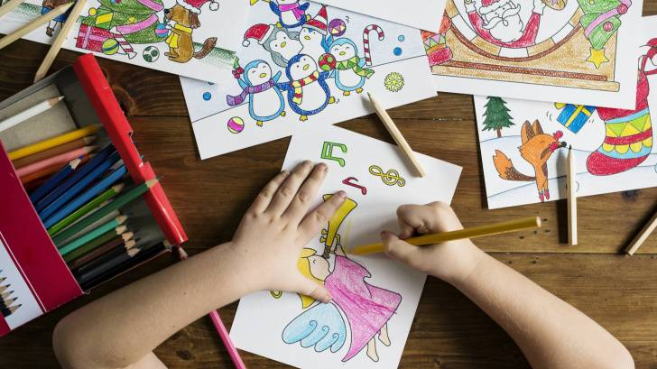 child coloring pictures in school