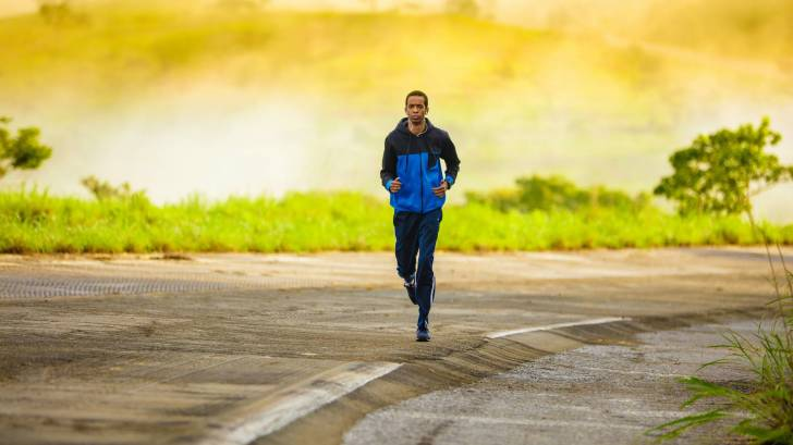 adult jogging on a lonely road
