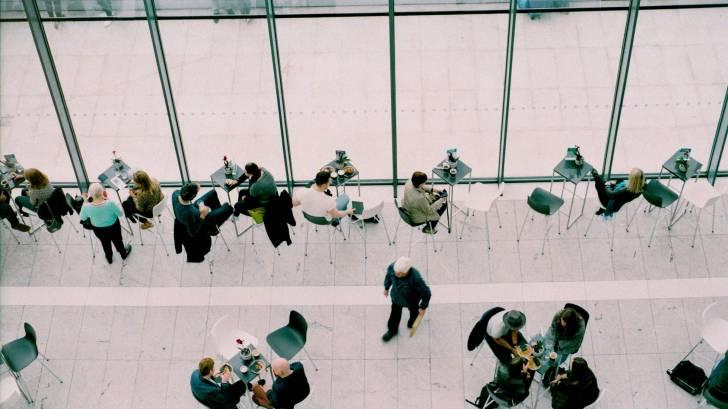 people meeting in coffee shop, talking