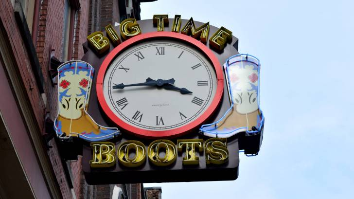 neon sign clock with boots