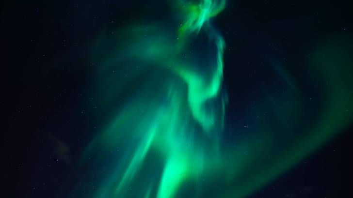 northern lights over the universe