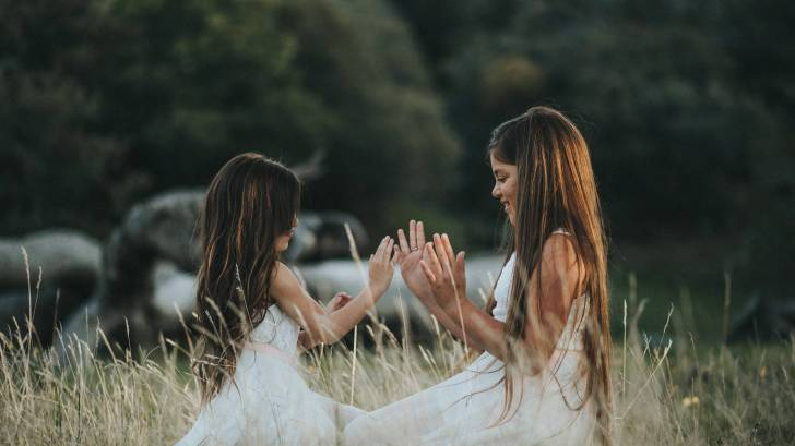 two young girls playing in a field