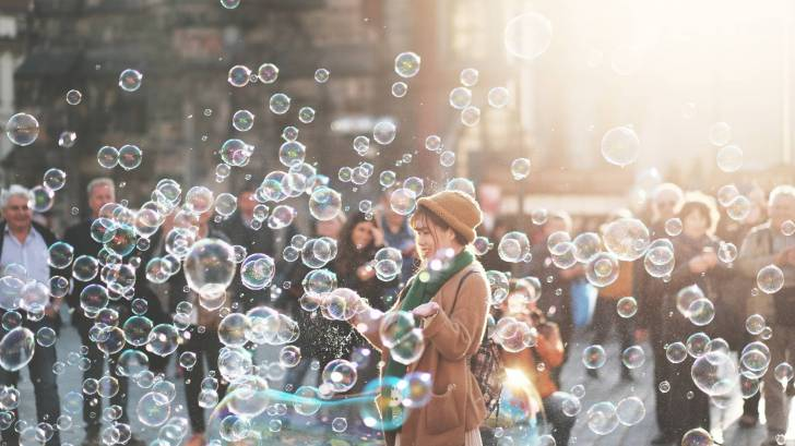 crowd of people in street with bubbles representing flu germs