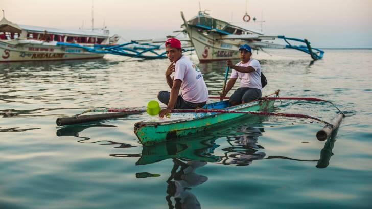philippine fishermen on a calm sea