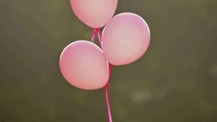 pink balloons celebrating
