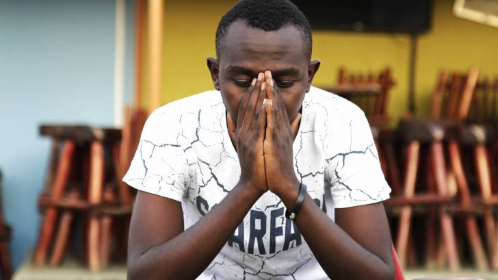 uganda man in prayer