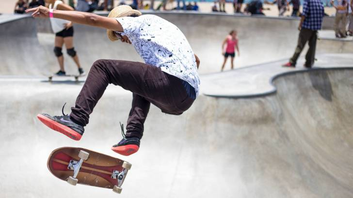 young people at skate park, risky moves