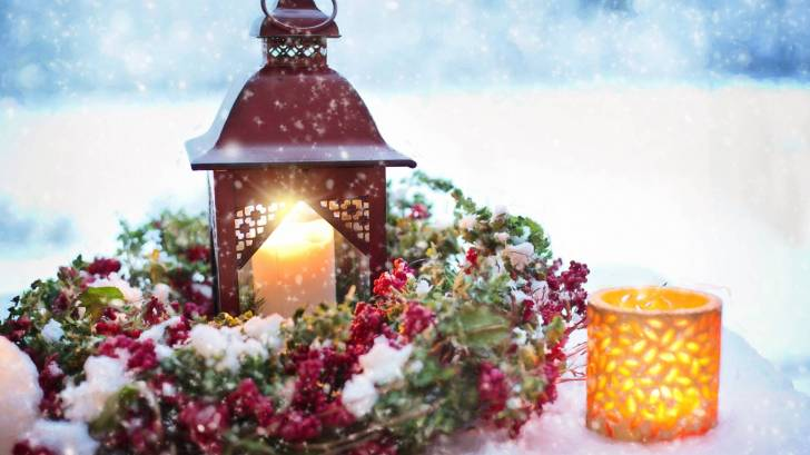 winter scene with snow and candles