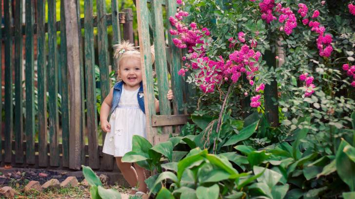 little girl in a garden