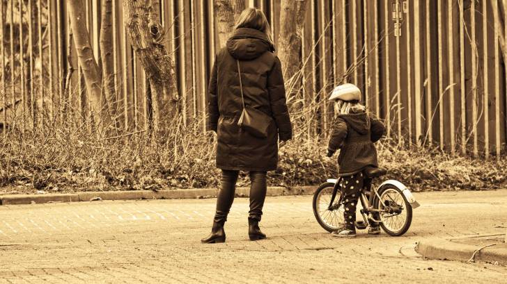 mom and young girl on her bike