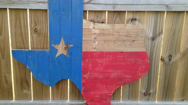 texas flag on wooden board