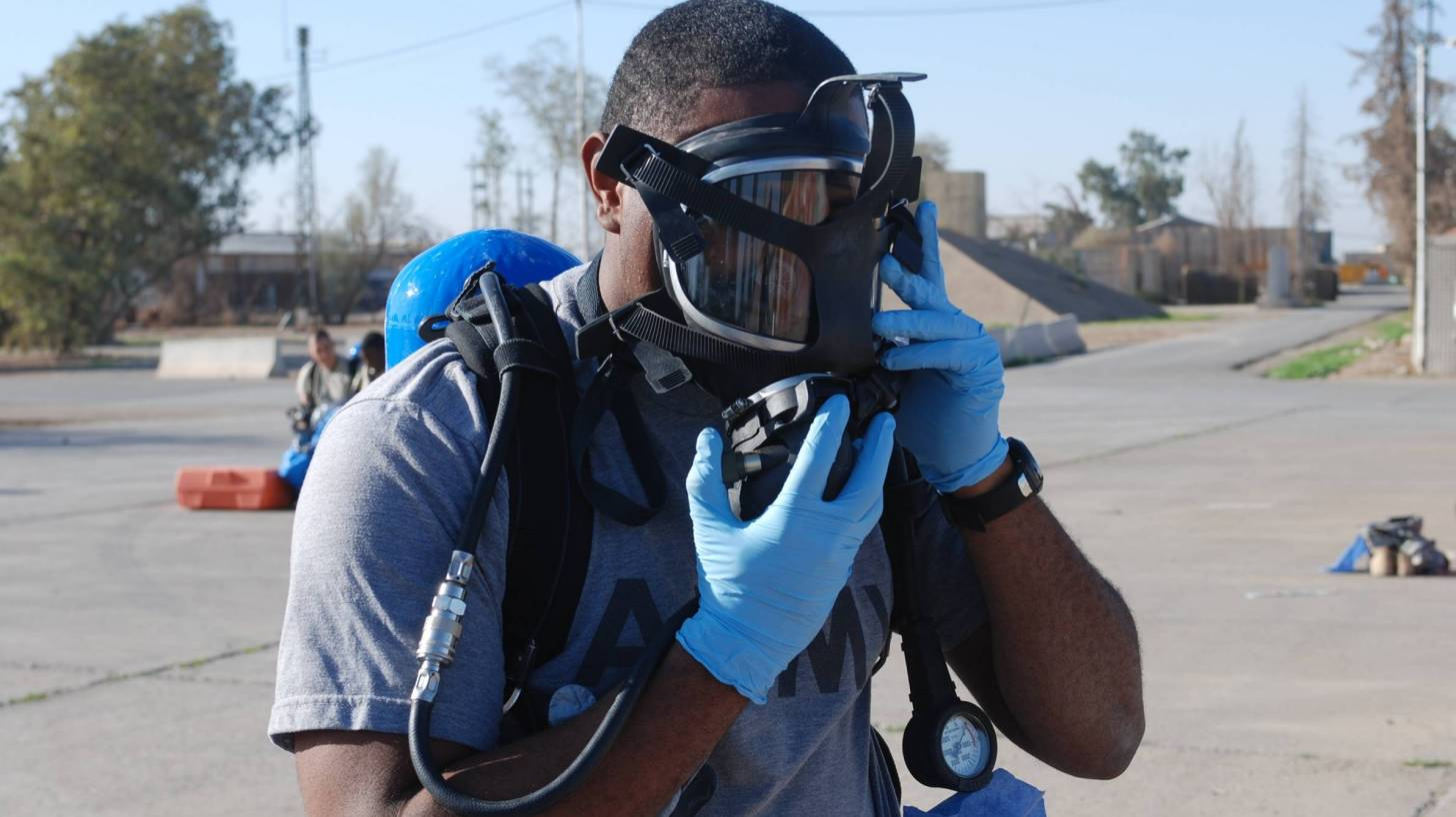 first responder with a gas mask on