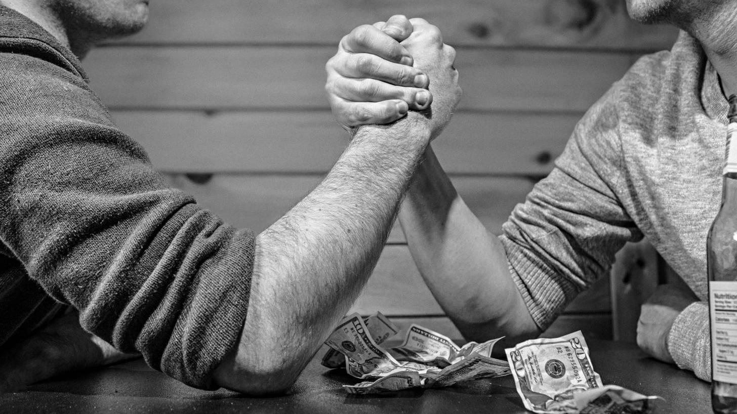 men arm wrestling
