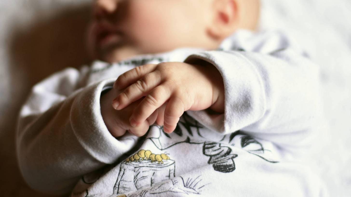 baby sleeping with chubby fingers