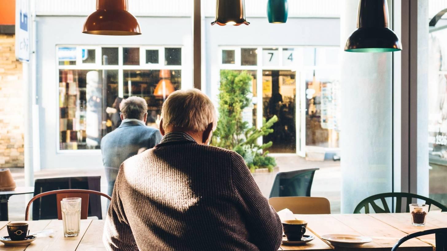 older men sitting in a cafe