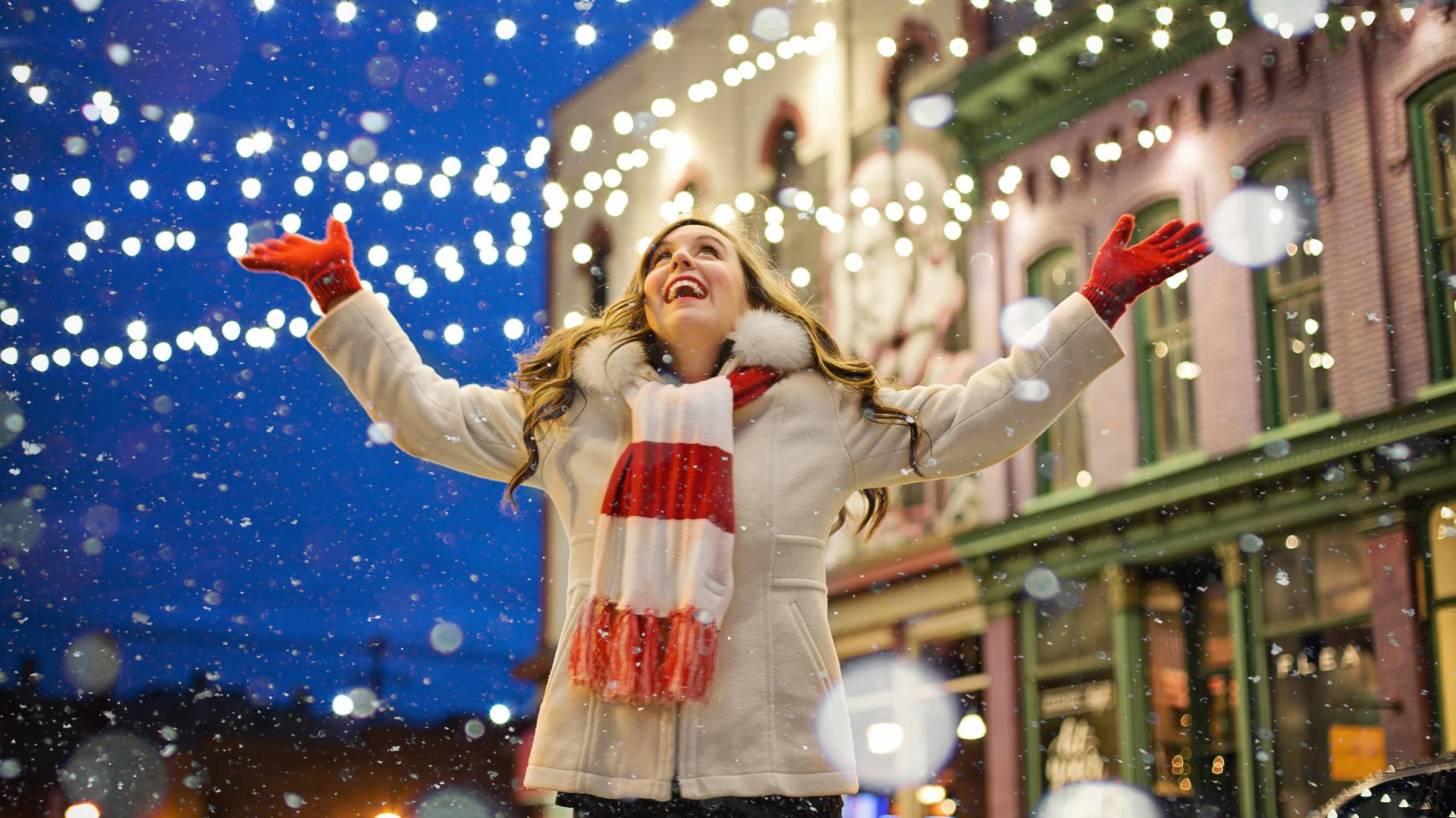 happy lady, lights in a winter scene