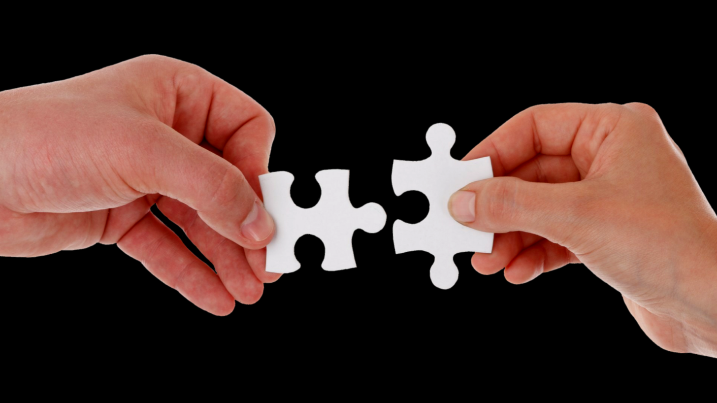 putting two pieces of a puzzle together
