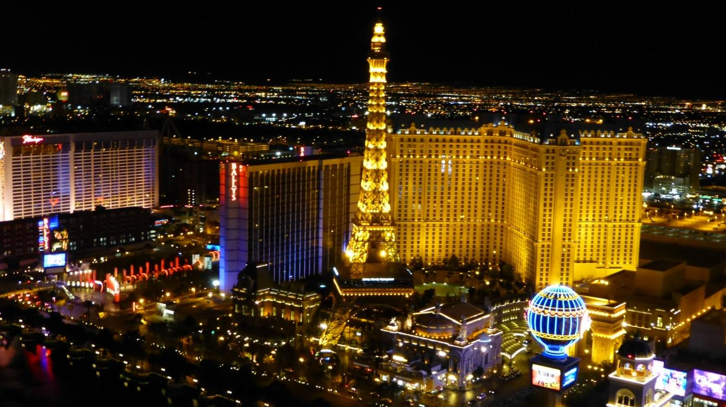 las vegas at night eiffel tower and other buildings