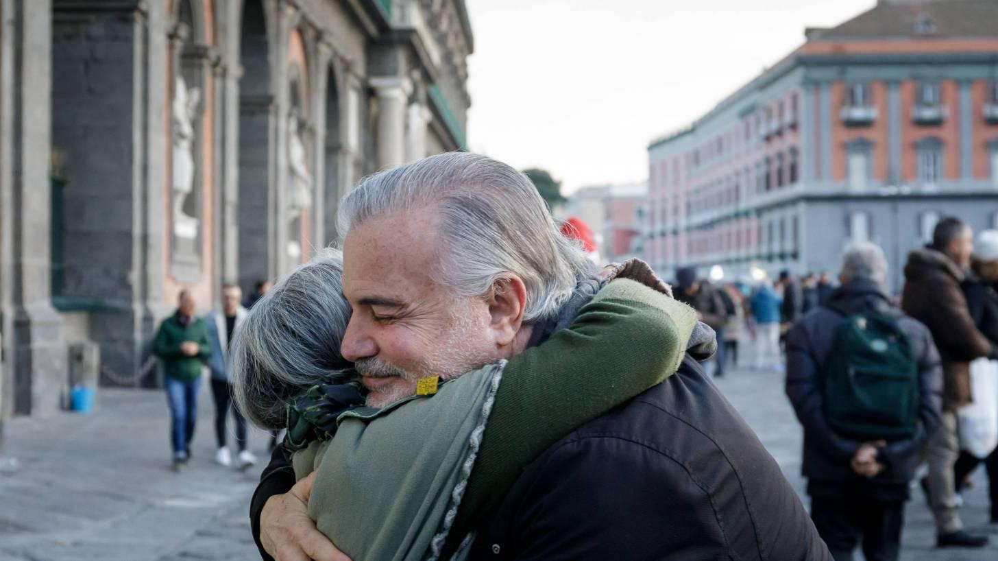 elderly people hugging