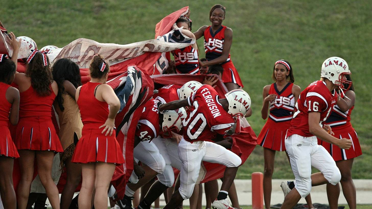 texas football team and cheerleaders