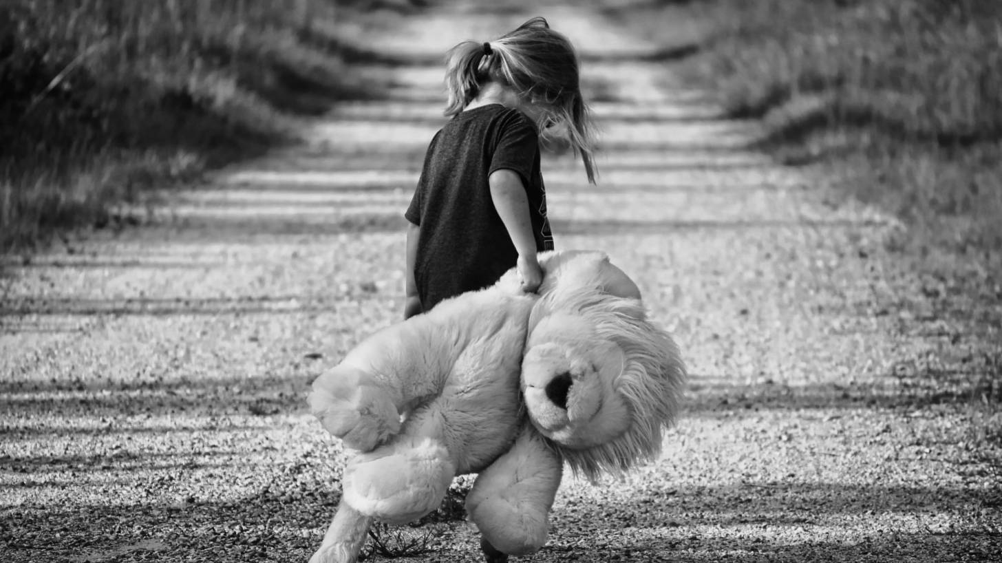 girl walkng teddy bear