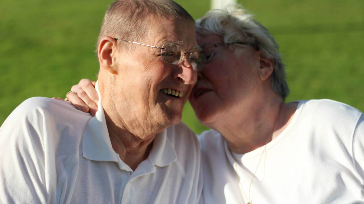 older couple laughing and healthy
