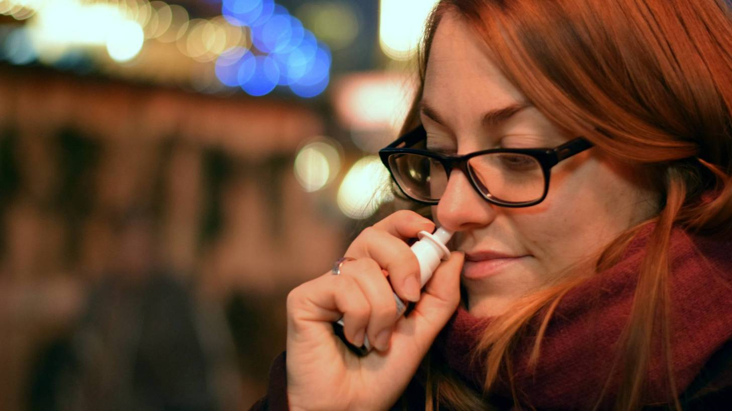 woman using a nasal spray