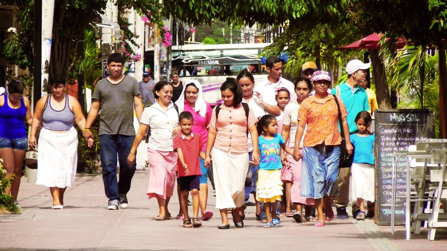 latino large extended family walking together