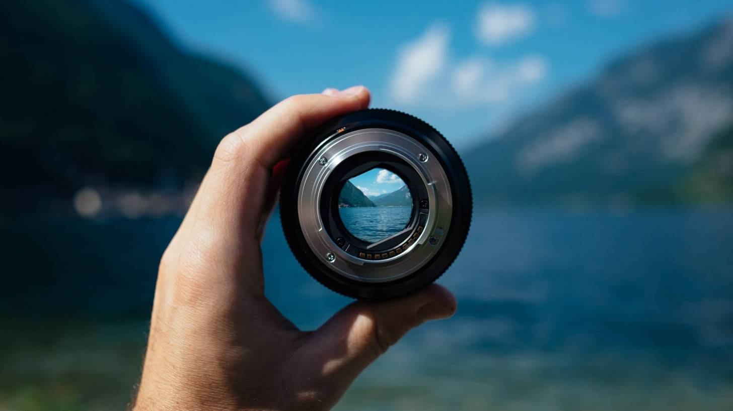 camera lens looking at the mountains to get over