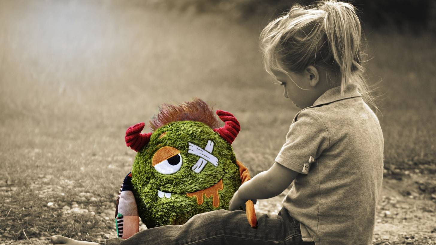 little girl with a sick stuffed animal