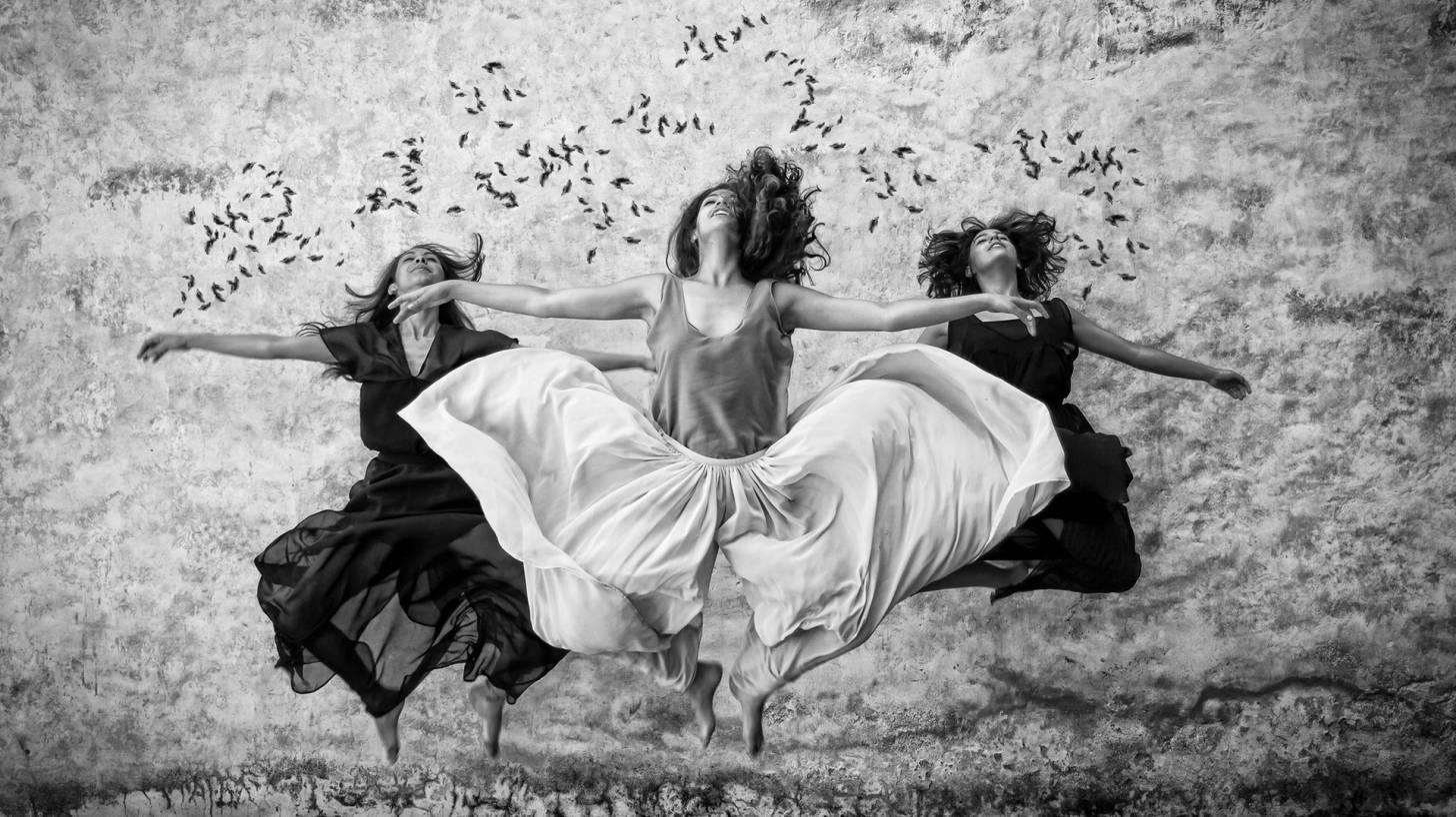 women jumping in a dance
