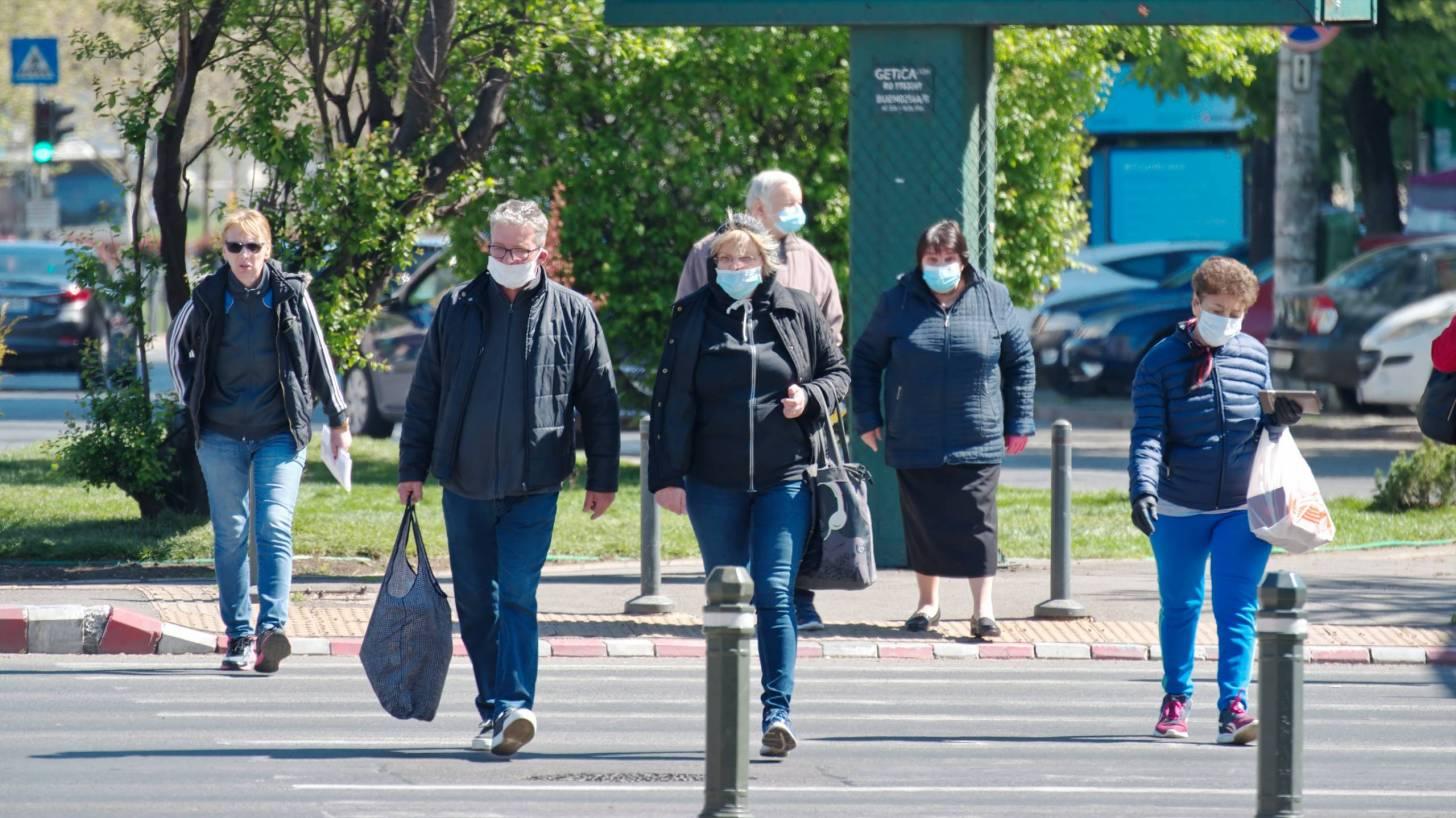 people wearing masks crossing the road