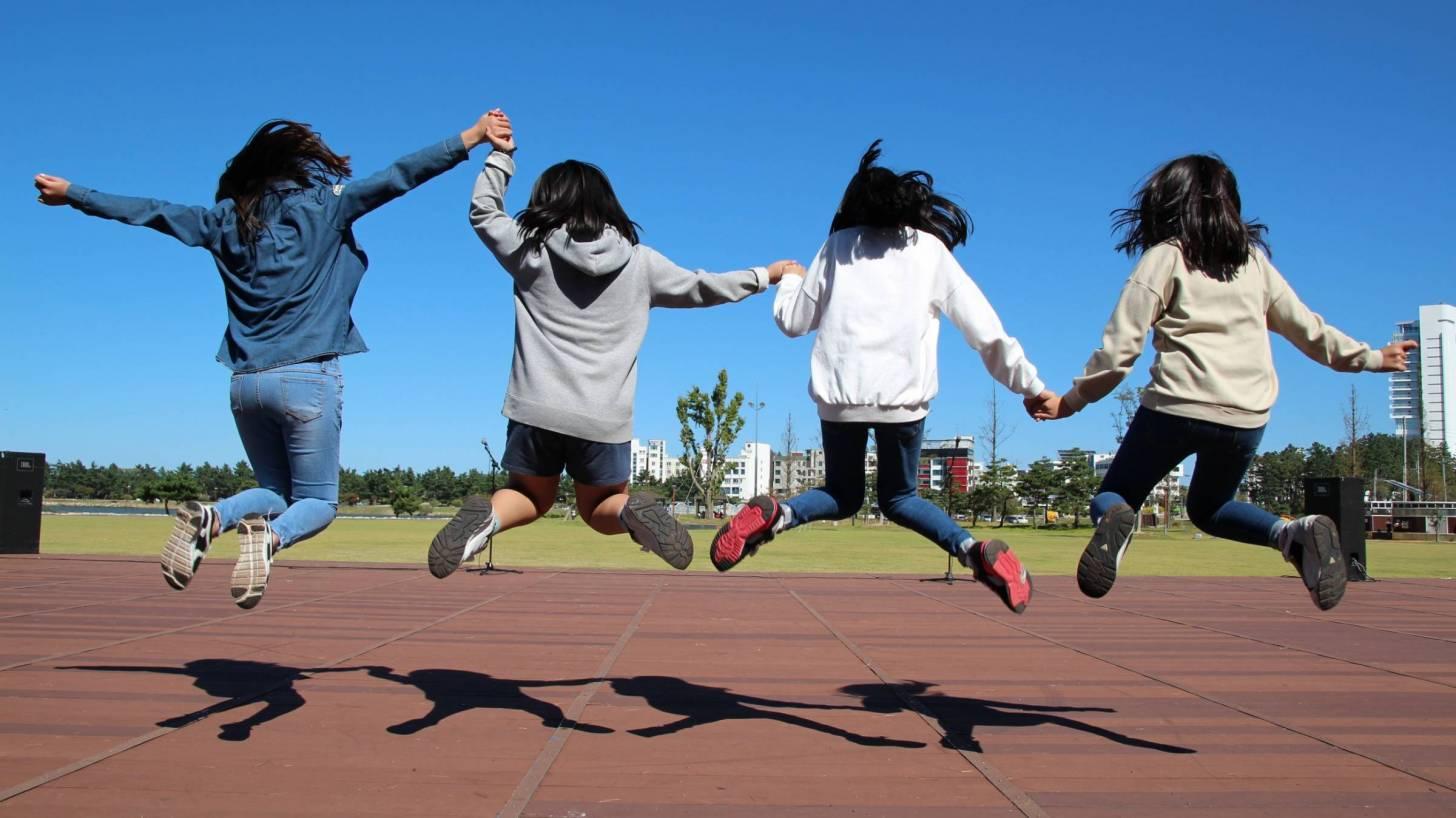girls jumping for joy