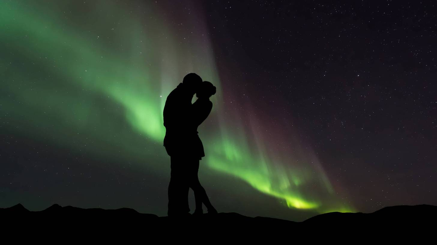 couple in front of northern lights